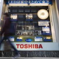 Toshiba profit triples on asset sales