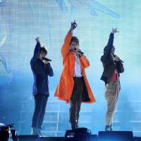 Members of the all-male pop group SMAP perform at a September 2011 concert in Beijing.  | | CHINA DAILY / VIA REUTERS