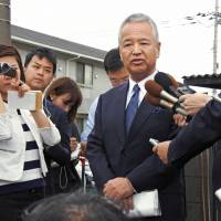 Former economy minister Akira Amari speaks in Yamato, Kanagawa Prefecture, in early June after announcing his return to politics. | KYODO