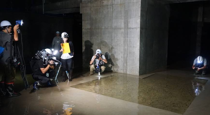 Reporters investigate ground water in the basement of the new Toyosu produce market in September.