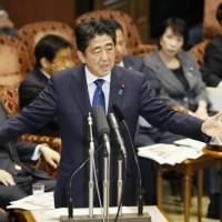 Prime Minister Shinzo Abe addresses a House of Councilors committee meeting in November. | KYODO
