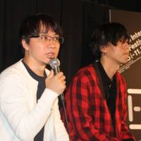 Perfect score: Director Makoto Shinkai and Radwimps singer Yojiro Noda discuss the film 'your name.' at the Tokyo International Film Festival last week. | KYODO