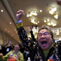 A Hillary supporter cheers at election night event in Las Vegas, Nevada. | REUTERS