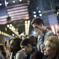 Clinton supporters watch the state-by-state returns at an election night rally in New York.  | REUTERS