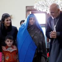 Pakistan-deported 1980s National Geographic 'Afghan girl' gets Kabul presidential welcome