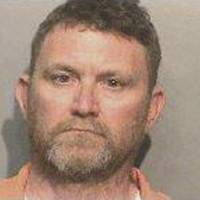 Iowa man with record of racist taunts in custody after ambush slayings of two cops