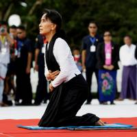 Myanmar State Counselor Aung San Suu Kyi attends an event marking the 69th anniversary of Martyrs' Day at the Martyrs' Mausoleum dedicated to fallen independence heroes in Yangon in July. | REUTERS