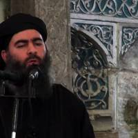 Islamic State group leader Abu Bakr al-Baghdadi addresses worshippers at a mosque in the militant-held northern Iraqi city of Mosul in this image taken from video released in July 2014. | AFP-JIJI