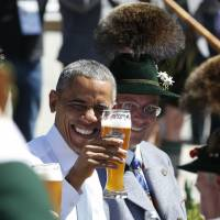 U.S. President Barack Obama toasts with a beer during a visit to the village of Kruen in southern Germany in June 2015, prior to the Group of Seven summit near Garmisch-Partenkirchen. | AP