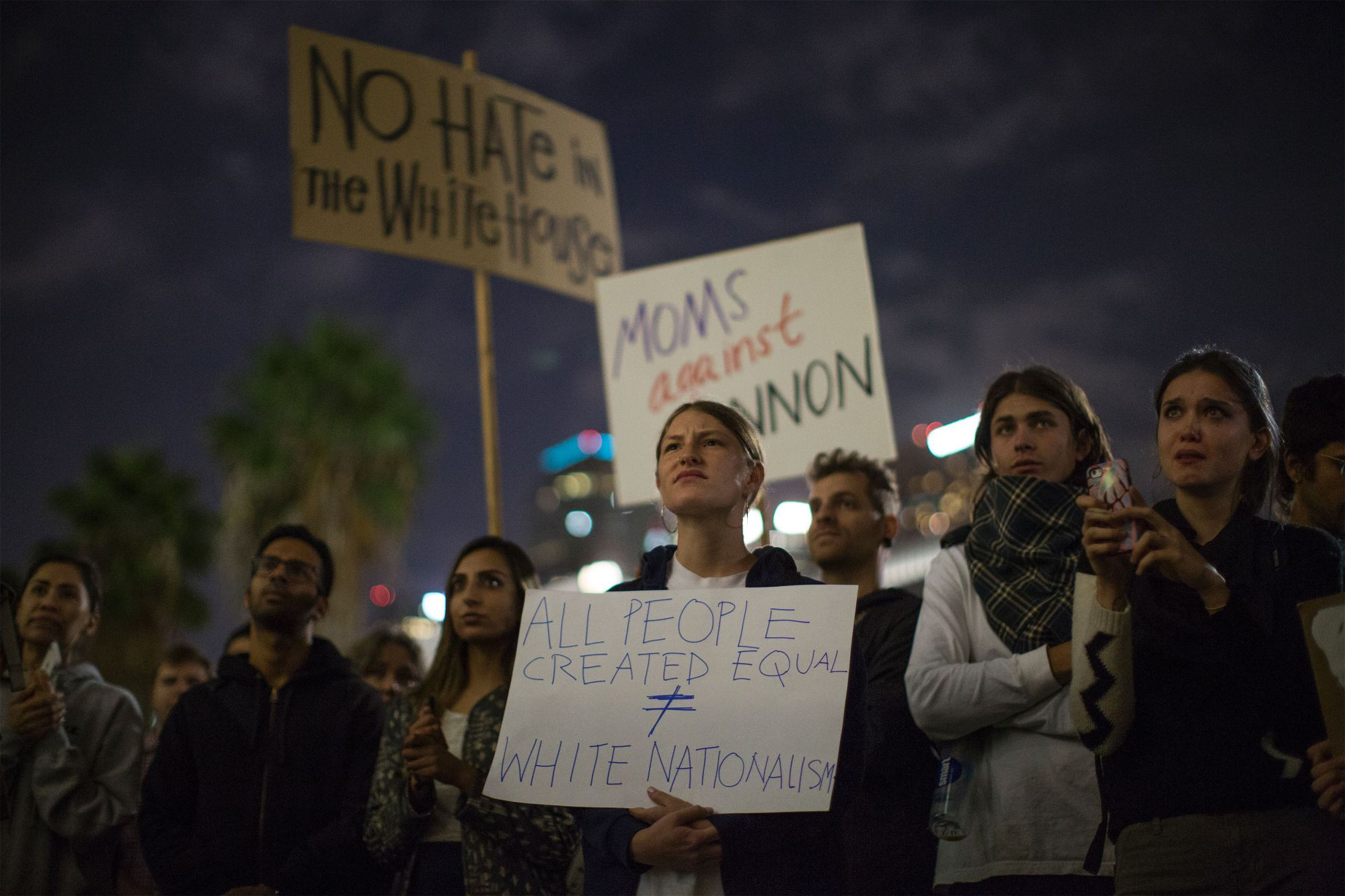 People outside Los Angeles City Hall in November protest Donald Trump's appointment of former Breitbart News head Steve Bannon, a white nationalist alt-right media mogul, to be chief strategist of the White House. | AFP-JIJI