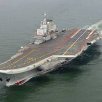 The Chinese aircraft carrier Liaoning cruises for a test in the sea in May 2012. | AP