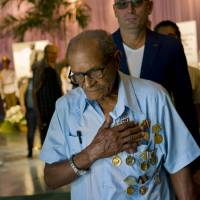 An elderly man wearing military medals holds his hand over his heart after paying his final respects to the late Fidel Castro in Havana Monday. Thousands of Cubans began lining up early for the start of week-long services bidding farewell to the man who ruled the country for nearly half a century. | AP