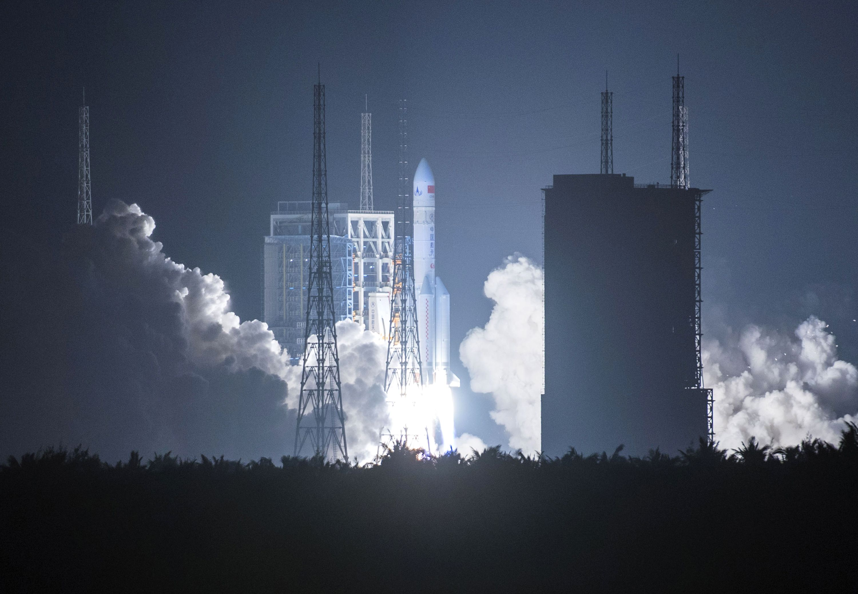 China's heavy-lift Long March-5 rocket blasts off from its launch center in Wenchang, in southern China's Hainan province, on Thursday. | AFP-JIJI