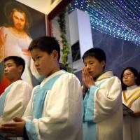 China priests wary of Vatican's olive branch