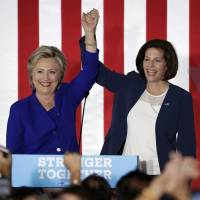 Democratic presidential candidate Hillary Clinton (left) and Democratic Senate candidate Catherine Cortez Masto take the stage at a rally Wednesday in Las Vegas. | AP