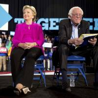 Democratic presidential candidate Hillary Clinton and Sen. Bernie Sanders appear at a rally at Coastal Credit Union Music Park at Walnut Creek in Raleigh, North Carolina, Thursday. | AP