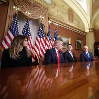 President-elect Donald Trump, wife Melania, Vice President-elect Mike Pence and House Speaker Paul Ryan, speak with reporters after their meeting on Capitol Hill in Washington on Thursday. | AP