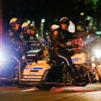 Two New York police officers shot, one fatally, in the Bronx
