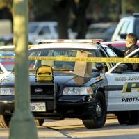 San Antonio detective slain in car while writing ticket outside police HQ