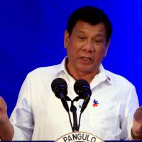 Philippine President Rodrigo Duterte gestures while delivering a speech during the 80th National Bureau of Investigation founding anniversary at its headquarters in Manila on Monday. | REUTERS