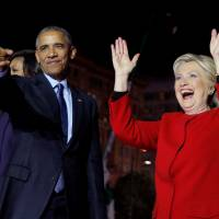 Democratic U.S. presidential nominee Hillary Clinton is joined by President Barack Obama at a campaign rally on Independence Mall in Philadelphia on Monday, the final day of campaigning before the election. | REUTERS