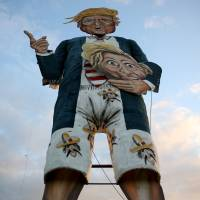 An effigy of Republican U.S. presidential candidate Donald Trump stands waiting to be burned as part of bonfire night celebrations in Edenbridge, England, on Saturday. | REUTERS