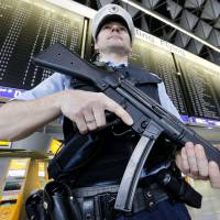 German police guard Frankfurt's airport on March 23, a day after suicide attacks at Brussels Airport. | AP