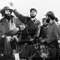 Cuban rebel leader Fidel Castro (center), surrounded by the members of his leftist guerrilla movement, waves from a jeep entering Havana after his victory over the forces of Cuban dictator Fulgencio Batista in January 1959. Castro died late Friday at the age of 90. | AFP-JIJI
