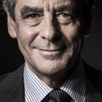 Francois Fillon, the center-right candidate in the 2017 French presidential election, poses for a portrait in Paris on Friday. | AFP-JIJI