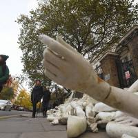 Piles of mannequin limbs are seen outside the Russian Embassy in London on Thursday as part of a protest against military action in Syria. | REUTERS