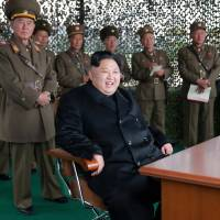 North Korean leader Kim Jong Un attends a firing contest among female gunners of the country's multiple launch rocket system in this undated photo released Saturday. | REUTERS