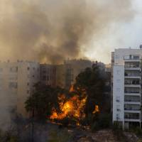 Wildfire blamed on terrorism roars through Israeli city