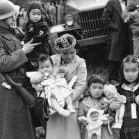 Shigeho Kitamoto and her four children are forcibly relocated along with others from Bainbridge Island, Washington, in March 1942 as part of the U.S. government's internment of people with Japanese ancestry. | AP