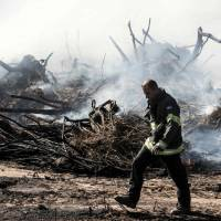 Israel douses blazes after mass evacuations, vows to find arsonists