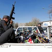 Water pipes are seen at the back of a police vehicle after being seized during a raid confiscating shisha water pipes in Kabul Sunday. | REUTERS