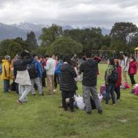 Stranded tourists gather Monday at a park in Kaikoura following an earthquake in New Zealand. | MARK MITCHELL / NEW ZEALAND HERALD POOL PHOTO VIA AP