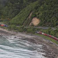 A photo taken and received Monday shows a freight train trapped by landslides near Kaikoura on the South Island's east coast. A powerful 7.8-magnitude earthquake killed two people and caused massive infrastructure damage in New Zealand, but officials said they were optimistic the death toll would not rise further. | AFP-JIJI