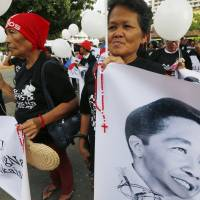 Court says Philippine dictator Marcos can be buried at heroes' cemetery