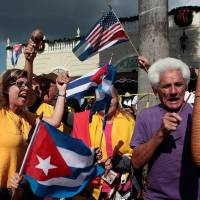 Miami's Cubans party hard over Castro death, see 'light at end of tunnel'