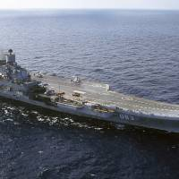 The carrier Admiral Kuznetsov is seen in the Barents Sea, Russia, in 2004. The Russian military says one of its the MiG-29 fighter jets based on the carrier currently near Syria's shores has crashed on a training mission, but its pilot survived. | AP