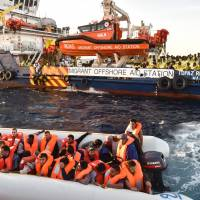 Rescued migrants recount smugglers' violence as Mediterranean death toll mounts, 100 more missing