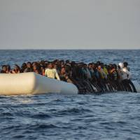 Some 1,400 migrants rescued, eight die as Italy braces for record arrivals