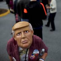 Donald Trump supporters wait in line outside before Melania Trump, wife to the Republican Presidential nominee, holds an event at Main Line Sports in Berwyn, Pennsylvania, Thursday. | REUTERS