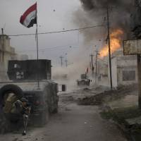 Low visibility over Mosul grounds air war as Islamic State wages deadly attacks