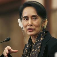 At the conclusion of her visit to Japan, Aung San Suu Kyi, Myanmar's foreign minister and state counselor, addresses a news conference in Tokyo on Friday. | AP