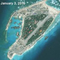 Satellite imagery released Tuesday by the Asia Maritime Transparency Initiative department at the Center for Strategic and International Studies think tank show Vietnam-held Spratly Island in the disputed South China Sea. | AFP-JIJI