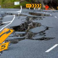 Earthquake damage to State Highway 1 is seen south of Kaikoura on Nov. 16. | AFP-JIJI