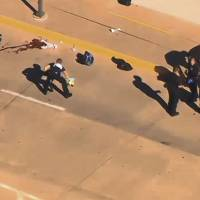 This still image taken from an aerial video provided by KWTV shows police responding to a shooting at Will Rogers World Airport in Oklahoma City on Tuesday. Police say the airport has been closed following the shooting there. Airport spokeswoman Karen Carney says all operations are suspended. | KWTV VIA AP