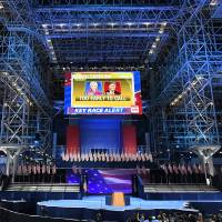 A screen displaying the election results is seen over the stage that Democratic presidential nominee Hillary Clinton will speak later during election night at the Jacob K. Javits Convention Center in New York on Tuesday. | AFP-JIJI