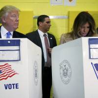 Republican U.S. presidential nominee Donald Trump and his wife, Melania Trump, vote in New York on Tuesday. | REUTERS
